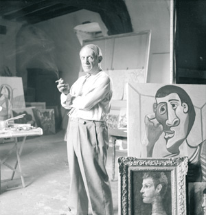 Picasso in his studio. Paris