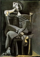 Man sitting knitting striped