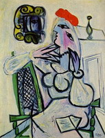 Woman sitting with a red hat