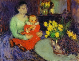 Mother and child in front of a vase of flowers