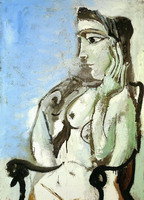 Nude woman sitting in a chair