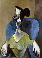 Woman sitting in a blue armchair